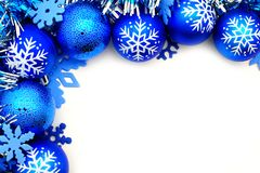 Christmas border. Blue Christmas corner border with baubles and snowflakes Royalty Free Stock Images