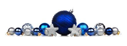 Christmas border of blue and silver ornaments isolated on white. Christmas border of blue and silver ornaments isolated on a white background stock photos