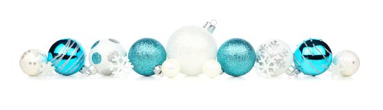 Christmas border of blue and white ornaments isolated on white. Christmas border of blue and white ornaments isolated on a white background royalty free stock image