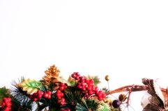 Christmas border. Christmas bottom border of artificial fir cone, holly and berries with glow Stock Photos
