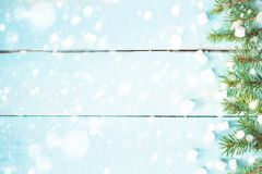 Christmas border with branch of fir tree and marshmallows on wooden background decorated with snow. Top view copy space royalty free stock images