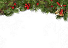 Christmas border branches and holly on white background Royalty Free Stock Images