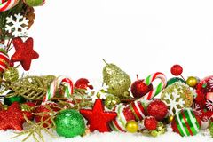 Christmas border of branches and ornaments in snow Royalty Free Stock Photo