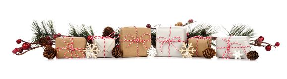 Christmas border with branches and brown and white gift boxes on white royalty free stock photos