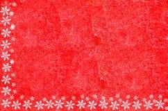 Christmas border composed of snow flakes. Christmas border on red brick wall Royalty Free Stock Photos