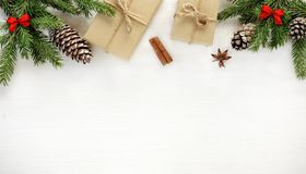 Christmas composition. Border made of christmas gifts and decoration. Christmas border composition made of fir branches, cones gift boxes wrapped in kraft paper royalty free stock photo