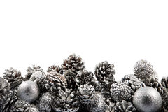 Christmas border with cones and balls. Space for Royalty Free Stock Photos