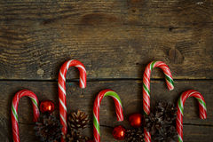Christmas border with cones, christmas decorations and candy can Royalty Free Stock Photography