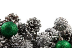 Christmas border with cones and green balls. Space Stock Images