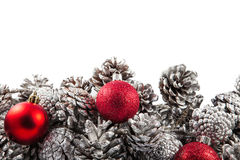 Christmas border with cones and red balls. Space Stock Photography