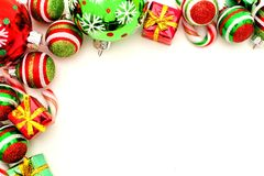 Christmas border. Christmas corner border with baubles, candy and gifts royalty free stock photography