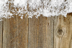 Christmas border decoration with snow on rustic wooden boards Royalty Free Stock Photos