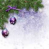 Christmas border with decorations on the frosty background. Christmas border with green fir branch, beautiful lilac ball on frosty background with place for Royalty Free Stock Photos