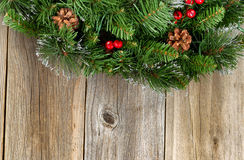 Christmas border with decorative wreath on rustic wooden boards Stock Photography