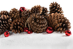 Christmas border design with snow, jingle bells and pinecones. Stock Photography