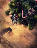 Christmas border design on the wooden background. Christmas fir tree with christmas candle and decoration Royalty Free Stock Photos