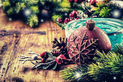 Christmas border design on the wooden background. Christmas fir tree with christmas candle and decoration Royalty Free Stock Images
