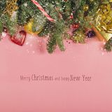 Christmas border with fir branches, conifer cones, christmas balls and golden christmas ornaments stock photo