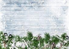 Christmas border with fir branches, jingle bells and snowfall. G stock image