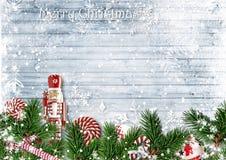 Christmas border with fir branches, nutcracker, candy and snowfall stock photo