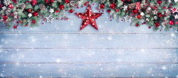 Christmas Border - Fir Branches And Ornament. On Snowy Plank stock photos