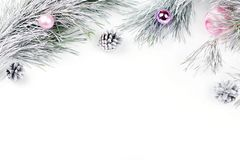 Christmas border with fir branches, presents, christmas ornaments on white background. Copy space stock photo