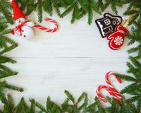 Christmas border with fir tree branches, christmas decorations a Royalty Free Stock Images