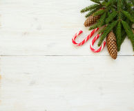Christmas border with fir tree branches with cones and candy can Royalty Free Stock Photo