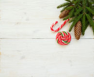 Christmas border with fir tree branches with cones and candy can Royalty Free Stock Photography