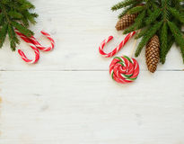 Christmas border with fir tree branches with cones and candy can Stock Photo