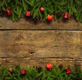 Christmas border with fir tree branches, cones and christmas dec Royalty Free Stock Image