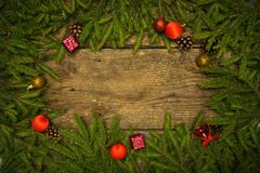 Christmas border with fir tree branches, cones and christmas dec Stock Images