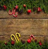 Christmas border with fir tree branches, cones, christmas decora Royalty Free Stock Photo