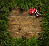 Christmas border with fir tree branches, cones and christmas dec Royalty Free Stock Images