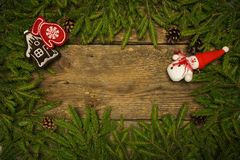 Christmas border with fir tree branches, cones and christmas dec Royalty Free Stock Photos