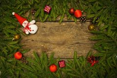 Christmas border with fir tree branches, cones and christmas dec Royalty Free Stock Photography