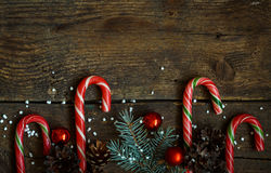 Christmas border with fir tree, cones, christmas decorations and Royalty Free Stock Photos