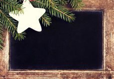 Christmas border with Fir Tree on Vintage Christmas Blackboard f Royalty Free Stock Photography