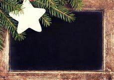 Christmas border with Fir Tree on Vintage Christmas Blackboard f Royalty Free Stock Photography