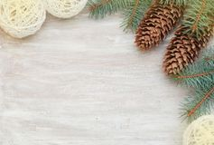 Christmas border or frame corner design with fir branch and pinecones on rustic wooden background. Royalty Free Stock Photo