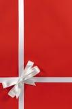 Christmas border frame gift ribbon on red paper background vertical Stock Photo