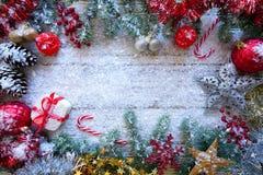 Christmas border frame on white snow stock photography