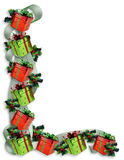 Christmas Border gifts, holly, ribbons Royalty Free Stock Photo