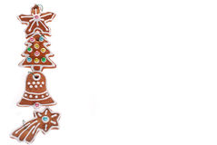 Christmas border with gingerbread cookies isolated on white Royalty Free Stock Photos