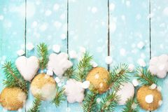 Christmas border with gingerbread, marshmallow and branch of fir tree decorated with snow.  royalty free stock photo