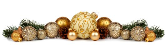 Christmas border of gold ornaments and branches isolated on white Royalty Free Stock Photo