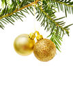 Christmas border with golden baubles. Christmas border with pine tree branch and golden baubles. Isolated on white background. Room for your text Royalty Free Stock Photography
