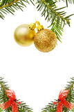 Christmas border with golden baubles and pine tree. Christmas border with pine tree branch, red ribbons and golden baubles. Isolated on white background. Room Royalty Free Stock Image