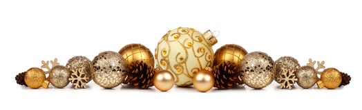 Christmas border of golden ornaments isolated on white Royalty Free Stock Image