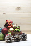 Christmas border with golden, red, green ornament and snow on wood background. Stock Image